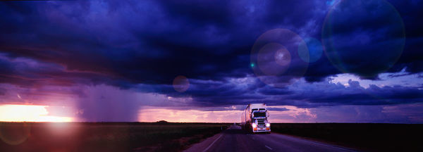 Road train at sunset