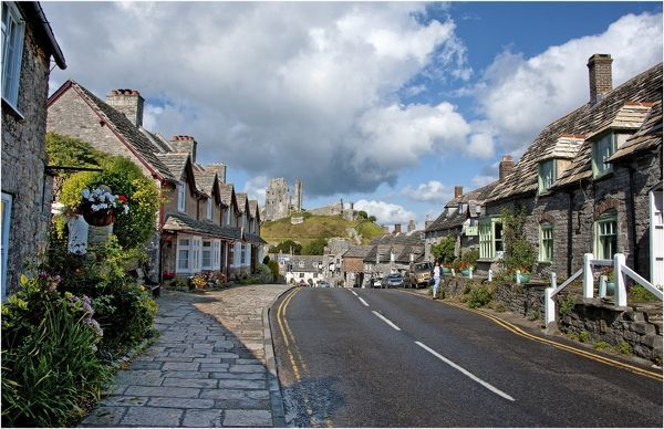 A view down the high Street of Corfe Castle, Isle of Purbeck, Dorset, England