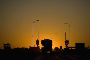travel/western australia wa north west pilbara port hedland/freight truck car stopped railroad crossing silhouetted