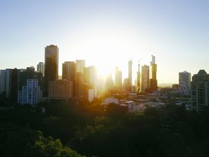 aerials/drone aerial views/sunset aerial view melbourne skyline trees carlton
